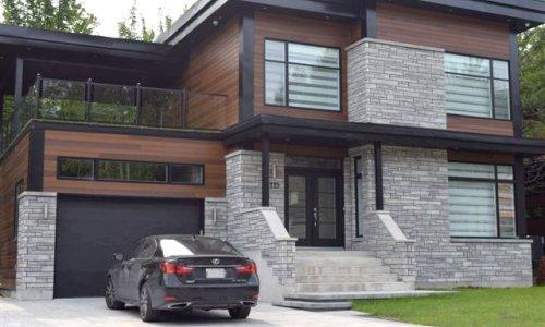Maison bois et brique moderne